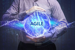 Business, Technology, Internet and network concept. Young businessman shows the word: Agile stock photos