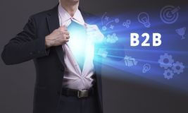 Business, Technology, Internet and network concept. Young businessman shows the word: B2B royalty free stock photos