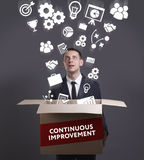 Business, Technology, Internet and network concept. Young businessman shows the word: Continuous improvement stock photos