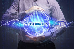 Business, Technology, Internet and network concept. Young businessman shows the word: Outsourcing royalty free stock images