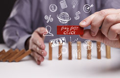 Business, Technology, Internet and network concept. Young businessman shows the word: pay per click stock photos