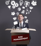 Business, Technology, Internet and network concept. Young busine. Ssman shows the word: Risk management Royalty Free Stock Photo