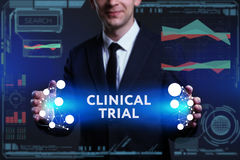 Business, Technology, Internet and network concept. Young busine. Ssman working on a virtual screen of the future and sees the inscription: Clinical trial Royalty Free Stock Photo