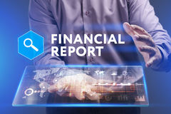 Business, Technology, Internet and network concept. Young busine. Ssman working on a virtual screen of the future and sees the inscription: Financial report Royalty Free Stock Photos