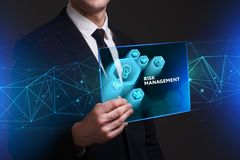 Business, Technology, Internet and network concept. Young busine. Ssman working on a virtual screen of the future and sees the inscription: Risk management Stock Photo