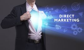 Business, Technology, Internet and network concept. Young businessman shows the word: Direct marketing. Business, Technology, Internet and network concept. Young royalty free stock images