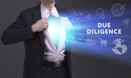 Business, Technology, Internet and network concept. Young businessman shows the word: Due diligence stock photo