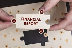 Business, Technology, Internet and network concept. Young busine. Ssman shows the word: Financial report Royalty Free Stock Images