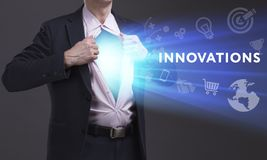Business, Technology, Internet and network concept. Young businessman shows the word: Innovations royalty free stock photos