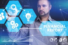 Business, Technology, Internet and network concept. Young busine. Ssman shows the word on the virtual display of the future: Financial report Stock Image