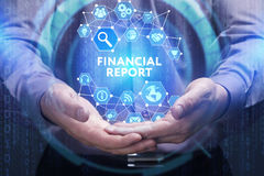Business, Technology, Internet and network concept. Young busine. Ssman shows the word on the virtual display of the future: Financial report Stock Photography