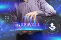 Business, Technology, Internet and network concept. Young busine. Ssman shows the word on the virtual display of the future: Firewall Royalty Free Stock Image