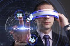 Business, Technology, Internet and network concept. Young busine. Ssman working in virtual reality glasses sees the inscription: Governance Royalty Free Stock Photo