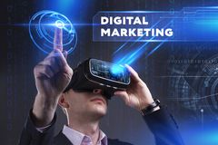 Business, Technology, Internet and network concept. Young busine. Ssman working in virtual reality glasses sees the inscription: Digital Marketing Royalty Free Stock Photography