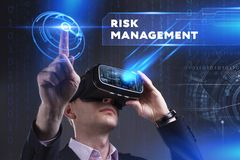 Business, Technology, Internet and network concept. Young busine. Ssman working in virtual reality glasses sees the inscription: Risk management Stock Photography