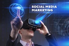 Business, Technology, Internet and network concept. Young busine. Ssman working in virtual reality glasses sees the inscription: Social media marketing Royalty Free Stock Image