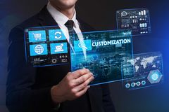 Business, Technology, Internet and network concept. Young busine. Ssman working on a virtual screen of the future and sees the inscription: Customization Royalty Free Stock Photo