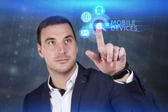Business, Technology, Internet and network concept. Young businessman working on a virtual screen of the future and sees the royalty free stock images
