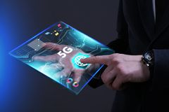 Business, Technology, Internet and network concept. Young busine. Ssman working on a virtual screen of the future and sees the inscription: 5G Stock Image