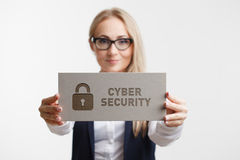 Business, Technology, Internet and network concept. Young girl holding a sign with an inscription cyber security Royalty Free Stock Images