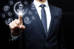 Business, technology, internet and networking. Businessman pressing sales team button on virtual screens Stock Photos