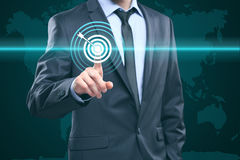 Business, technology, internet and networking concept - businessman pressing button with contact on virtual screens. World map Royalty Free Stock Photography