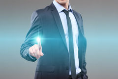 Business, technology, internet and networking concept - businessman pressing button with contact on virtual screens. World map Stock Photo