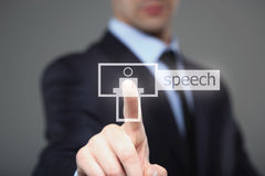 Business, technology, internet and networking concept - businessman pressing speech button on virtual screens. Stock Photo
