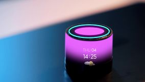 Smart speaker with date, time and day of week. Business, technology and internet of things concept - glowing violet smart speaker with date, time and day of week stock video