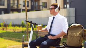 Businessman with tablet pc, headphones and coffee stock video footage