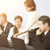 Business, technology and office concept - smiling business team Stock Photography