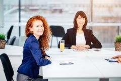 Business, technology and office concept - smiling female boss talking to team Royalty Free Stock Image