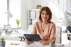 Businesswoman with tablet pc working at office. Business, technology and people concept - businesswoman with tablet pc computer working at office Stock Photos
