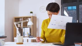 Creative woman working on user interface at office stock video