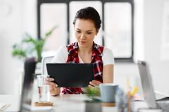 Creative woman with tablet pc working at office royalty free stock photo