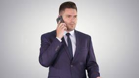 Business, technology and people concept - smiling businessman with smartphone talking on gradient background. Medium shot. Business, technology and people stock video