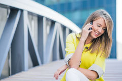 Business, technology and people concept - smiling businesswoman with smartphone talking over office building. Royalty Free Stock Photography