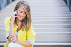 Business, technology and people concept - smiling businesswoman with smartphone talking over office building. Stock Photos