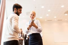 Couple with smartphone at business conference Royalty Free Stock Photo
