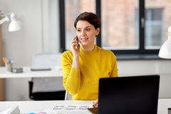 Ui designer calling on smartphone at office stock images