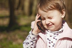 Business telephone conversation. Beautiful business child girl s royalty free stock image