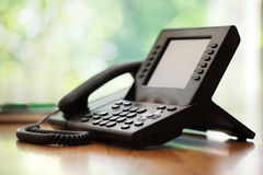 Business telephone. With liquid crystal display on a desk in an office Stock Images