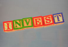 Business term - Invest. A business term used at many meetings - invest Stock Photos