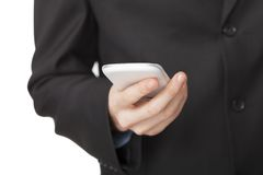 Business texting on his cell phone Stock Images