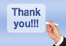 Business thank you sign. Hand of a businessman writing thank young on a screen with a marker pen Stock Photo