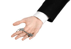 Business theme: real estate agent in the jacket in his hand the key to a new apartment on the white isolated background Stock Images
