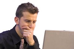 Business thoughts in front of laptop Stock Images