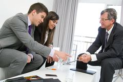 Business threesome at meeting. Stock Images