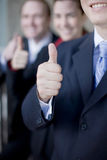 Business Thumbs-up. Three businesspeople standing and smiling giving thumbs up Royalty Free Stock Image