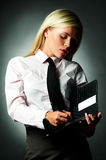 Business Tie. Young Business woman wearing white shirt and black tie and note book royalty free stock photography